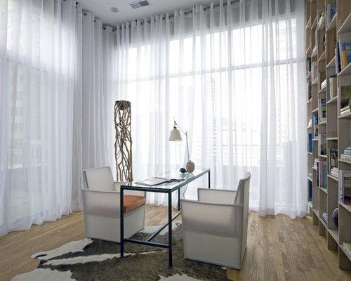 Contemporary Medium Tone Wood Floor Home Office Idea In Birmingham With A Freestanding Desk