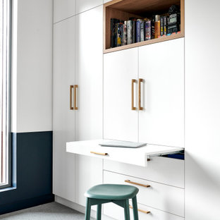 Inspiration for a mid-sized scandinavian home office in Sydney with white walls, carpet and grey floor.