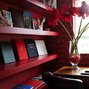 Example of a small asian freestanding desk carpeted study room design in Dorset with red walls