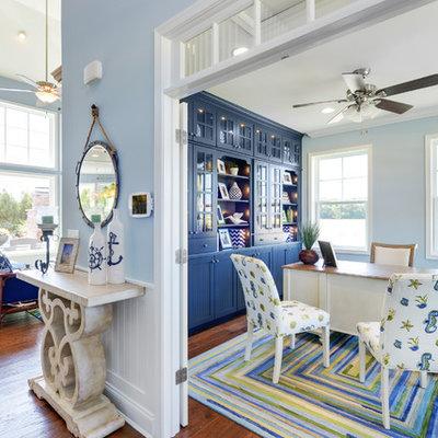 Example of a beach style freestanding desk medium tone wood floor study room design in Philadelphia with blue walls