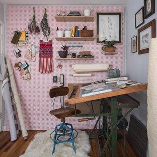 Craft room - scandinavian freestanding desk dark wood floor and brown floor craft room idea in Austin