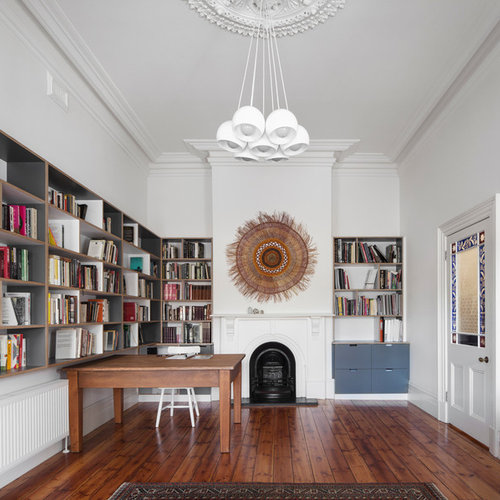 Mid Sized Scandinavian Study Room In Melbourne With A Standard Fireplace, A  Wood Fireplace