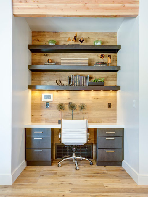 trendy home office photo in salt lake city with medium tone hardwood floors a built