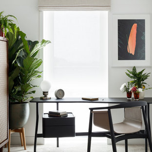 Inspiration for a contemporary study in London with white walls, carpet, no fireplace, a freestanding desk and grey floors.