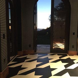 ロサンゼルスの巨大なモダンスタイルのおしゃれなアトリエ・スタジオ (リノリウムの床) の写真