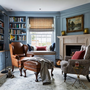 Photo of a medium sized classic home office and library in Brisbane with a reading nook, blue walls and grey floors.