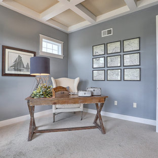 Design ideas for a mid-sized arts and crafts study room in Other with blue walls, carpet, no fireplace, a freestanding desk and brown floor.