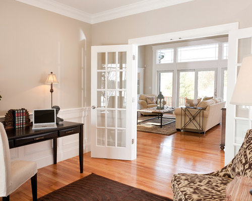 Example Of A Classic Medium Tone Wood Floor And Beige Home Office Design In Boston