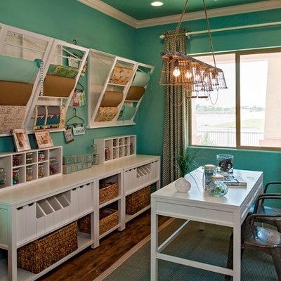 Example of a classic freestanding desk dark wood floor home office design in Phoenix with blue walls