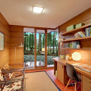 This is an example of a small midcentury study room in Seattle with no fireplace and a built-in desk.