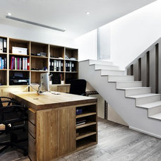 Contemporary Home Office by S.I.D.Ltd.