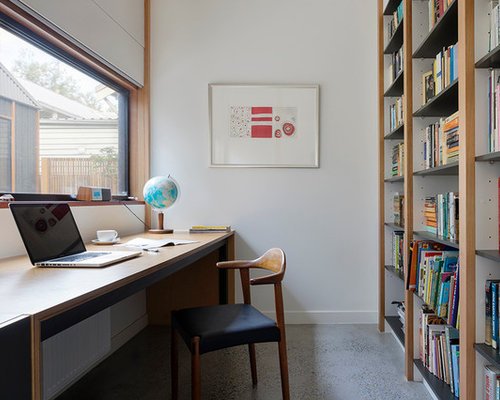 Inspiration For A Contemporary Study Room In Melbourne With White Walls,  Concrete Floors And A