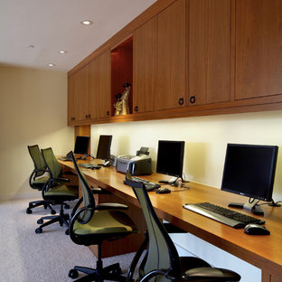 Inspiration for a mid-sized contemporary built-in desk carpeted study room remodel in San Francisco with beige walls