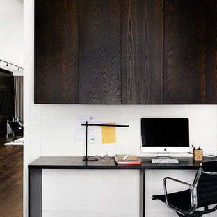 Contemporary study room in Melbourne with white walls, carpet and a freestanding desk.