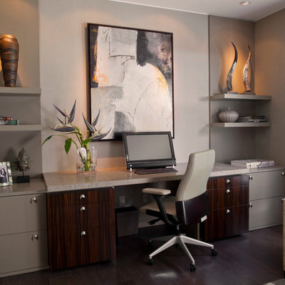 Study room - large contemporary built-in desk dark wood floor study room idea in Miami with gray walls and no fireplace