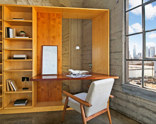 building a home office. example of an urban freestanding desk concrete floor and gray home office design in los building a m