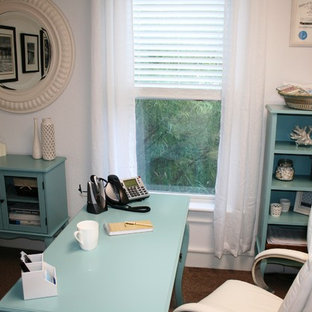 Example of a small coastal freestanding desk carpeted home office design in Other with white walls and no fireplace