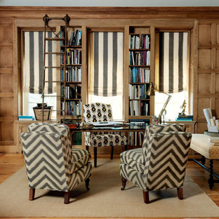 Inspiration for a timeless freestanding desk medium tone wood floor home office remodel in Other