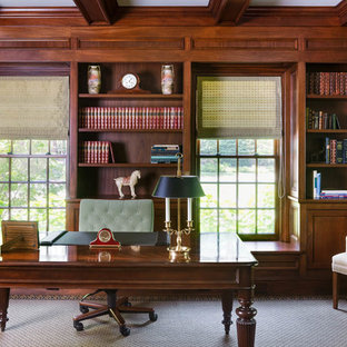 Study room - large traditional freestanding desk medium tone wood floor and brown floor study room idea in Boston with brown walls and no fireplace