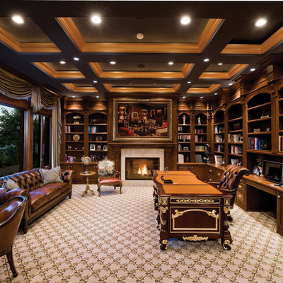 Inspiration for a timeless freestanding desk carpeted home office remodel in Las Vegas with a standard fireplace