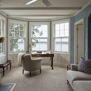 Design ideas for a medium sized traditional study in New York with blue walls, carpet, a standard fireplace, a metal fireplace surround, a freestanding desk and beige floors.