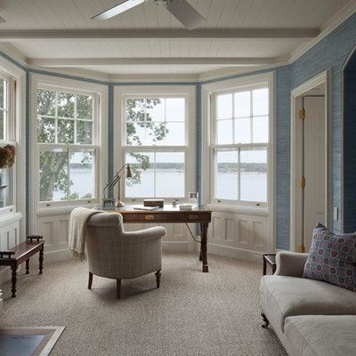 Study room - mid-sized traditional freestanding desk carpeted and beige floor study room idea in New York with blue walls, a standard fireplace and a metal fireplace