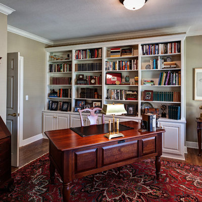 Inspiration for a mid-sized timeless freestanding desk medium tone wood floor study room remodel in Other with beige walls