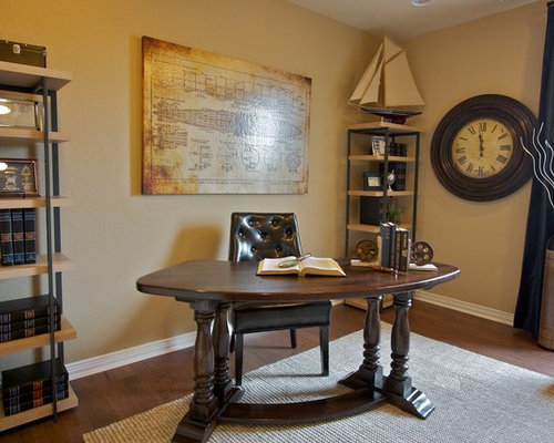 Example Of A Classic Freestanding Desk Dark Wood Floor Home Office Design  In Austin With Beige