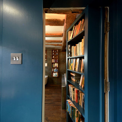 Inspiration for a small farmhouse freestanding desk dark wood floor study room remodel in Kent with blue walls and no fireplace
