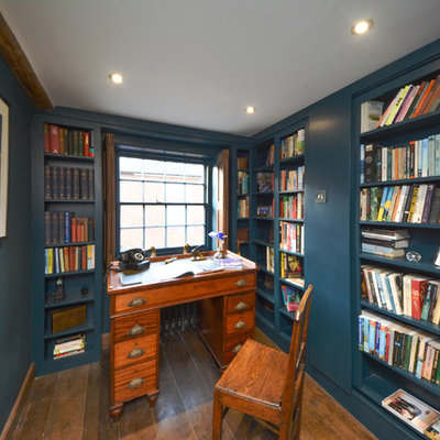 Inspiration for a small cottage freestanding desk dark wood floor study room remodel in Kent with blue walls and no fireplace