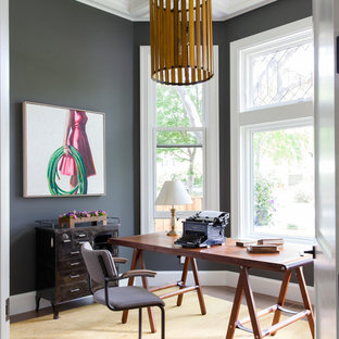 Inspiration for a transitional freestanding desk dark wood floor home office remodel in San Francisco with gray walls