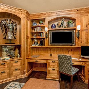 Example of a transitional built-in desk home office design in Other