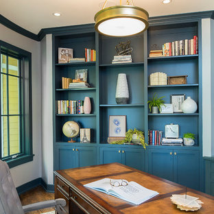 Inspiration for a mid-sized transitional freestanding desk dark wood floor and brown floor study room remodel in Milwaukee with gray walls