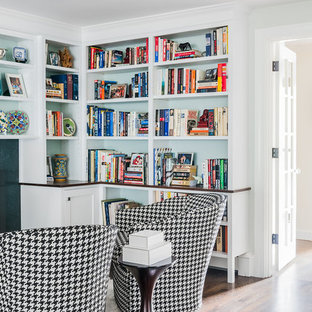 Design ideas for a medium sized traditional home office and library in Boston with green walls, dark hardwood flooring, a standard fireplace, a metal fireplace surround, a built-in desk and brown floors.