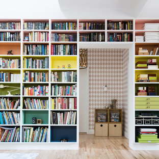 Example of a trendy light wood floor study room design in New York with white walls