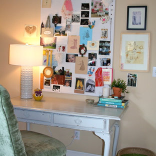 Example of an eclectic white floor home office design with beige walls