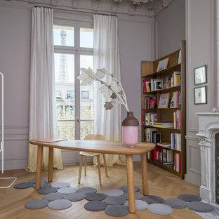 Idée de décoration pour un bureau tradition avec un mur gris, un sol en bois clair, une cheminée standard, un bureau indépendant et un sol marron.
