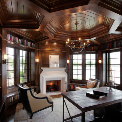 Home office - traditional freestanding desk dark wood floor home office idea in Minneapolis with a standard fireplace