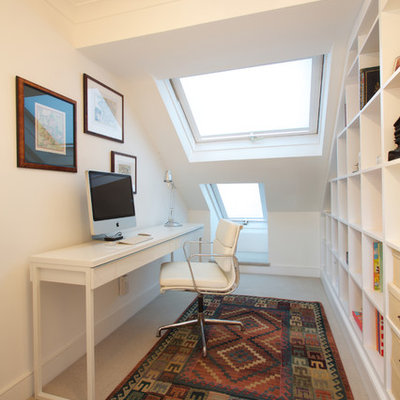 Inspiration for a contemporary freestanding desk carpeted study room remodel in London with white walls