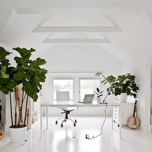 Inspiration for a contemporary white floor home office remodel in Portland