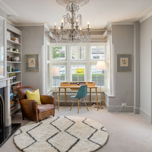 Inspiration for a classic study in London with grey walls, carpet, a standard fireplace, a freestanding desk and beige floors.