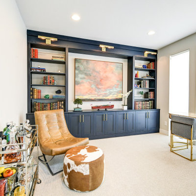 Study room - mid-sized eclectic freestanding desk carpeted and multicolored floor study room idea in Denver with beige walls