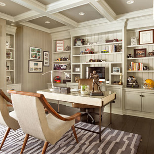 Study room - mid-sized traditional freestanding desk dark wood floor study room idea in New York with gray walls