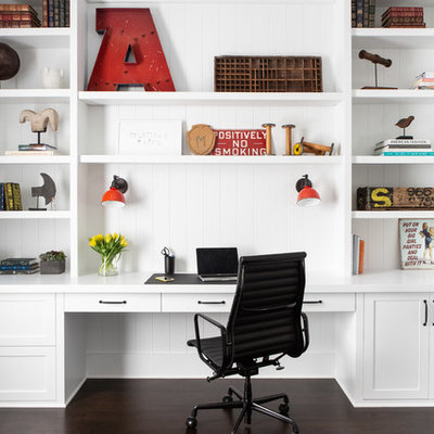 Inspiration for a large farmhouse built-in desk dark wood floor and brown floor study room remodel in New York with white walls