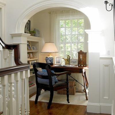 Small elegant freestanding desk dark wood floor study room photo in Boston with white walls