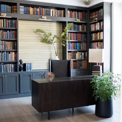 Example of a mid-sized transitional freestanding desk dark wood floor home office library design in Indianapolis with no fireplace