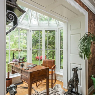 Cottage freestanding desk medium tone wood floor and brown floor study room photo in Other with white walls