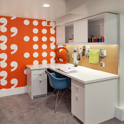 Inspiration for a contemporary built-in desk carpeted home office remodel in Portland with orange walls