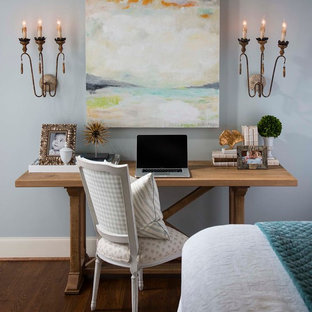 Home office - traditional freestanding desk dark wood floor home office idea in Dallas with blue walls