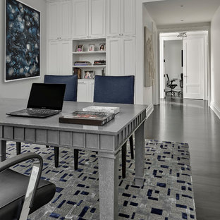 Example of a tuscan freestanding desk dark wood floor and brown floor home office design in Chicago with white walls